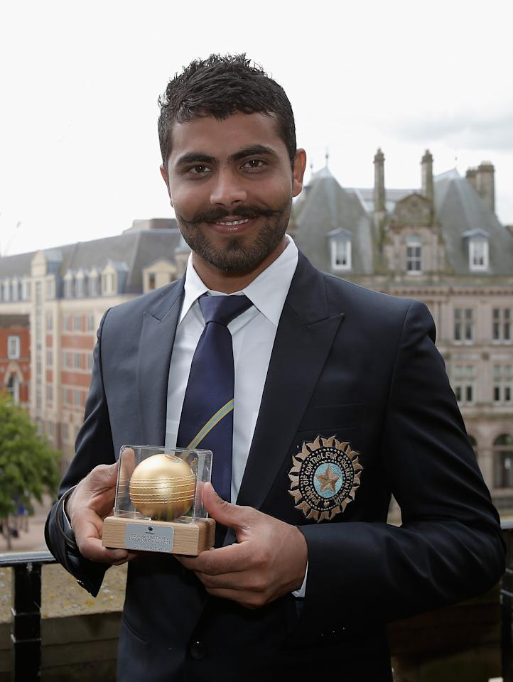 BIRMINGHAM, ENGLAND - JUNE 24: 'Man of the Match' Ravindra Jadeja poses with his trophy during a photocall for the winners of the ICC Champions Trophy on June 24, 2013 in Birmingham, England.  (Photo by Harry Engels-ICC/ICC via Getty Images)