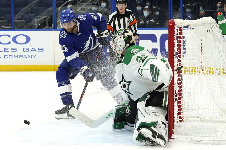 Tampa Bay Lightning center Brayden Point (21) misses a shot in front of Dallas Stars goaltender Jake Oettinger (29) during the second period of an NHL hockey game Wednesday, May 5, 2021, in Tampa, Fla. (AP Photo/Chris O'Meara)