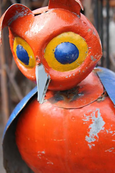 In this Saturday, May 19, 2012 photo, a whimsical owl sculpture is diplayed at Home & Garden Art in Seattle. The sculpture is made in the Southern U.S. from recycled oil drums, primarily salvaged in Texas. (AP Photo/Cedar Burnett)