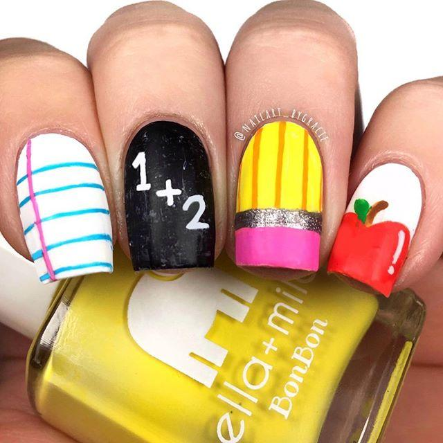 "<p>Paper, math, pencil, and an apple ... what more do you need for your first day? This design has it all, and plenty of variety that she (and her pals) will love. </p><p><a class=""body-btn-link"" href=""https://www.amazon.com/ella-mila-Polish-BonBon-Collection/dp/B01EFFWJ18/ref=sr_1_11_sspa?tag=syn-yahoo-20&ascsubtag=%5Bartid%7C10055.g.22590646%5Bsrc%7Cyahoo-us"" target=""_blank"">SHOP YELLOW POLISH</a></p><p><em><a href=""https://www.instagram.com/nailart_bygracie/"" target=""_blank"">See more from @nailart_bygracie »</a></em></p><p><strong>RELATED:</strong> <a href=""https://www.goodhousekeeping.com/beauty/nails/g2732/fall-nail-art-ideas/"" target=""_blank"">38 Nail Designs That Are So Perfect for Fall</a></p><p><a href=""https://www.instagram.com/p/BmfCEZtBAic/"">See the original post on Instagram</a></p>"