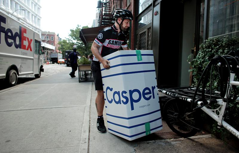 MANHATTAN, NY - AUGUST 28: Josh Weitzner, owner of Samurai Messenger Service, prepares to deliver a packaged mattress from the bed delivery company Casper in Manhattan, NY, on August 28, 2015. (Photo by Yana Paskova/For The Washington Post via Getty Images)