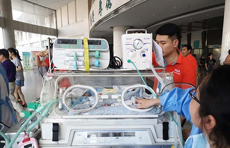 Premature twins the size of a hand airlifted to Shanghai in critical condition