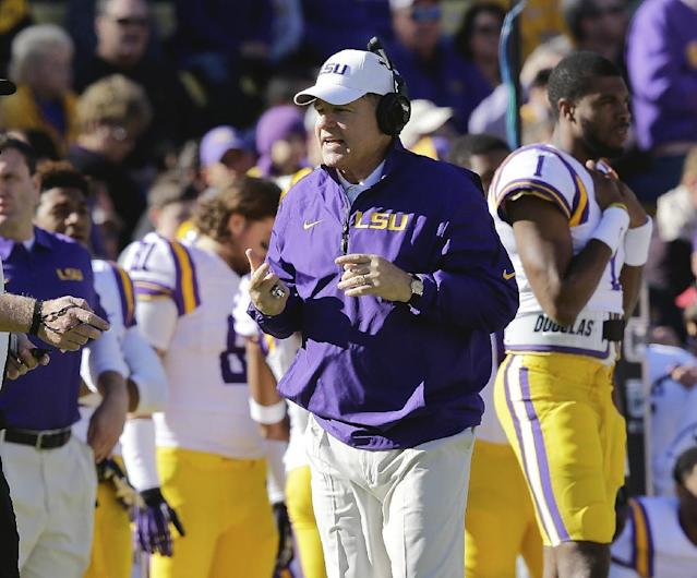 LSU head coach Les Miles talks to the officials in the first half of an NCAA college football game against Arkansas in Baton Rouge, La., Friday, Nov. 29, 2013. (AP Photo/Bill Haber)