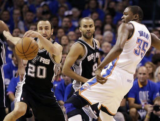 San Antonio Spurs shooting guard Manu Ginobili (20), of Argentina, Tony Parker (9), of France, and Oklahoma City Thunder small forward Kevin Durant react to a loose ball during the first half of Game 3 in their NBA basketball Western Conference finals playoff series, Thursday, May 31, 2012, in Oklahoma City. (AP Photo/Eric Gay)
