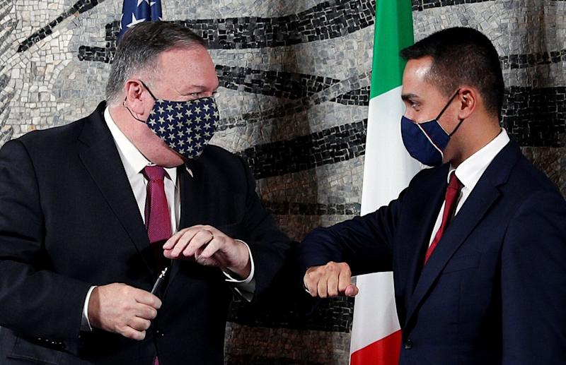 U.S. Secretary of State Mike Pompeo bumps elbows with Italian Foreign Minister Luigi Di Maio at the end of a joint news conference in Rome, Italy, September 30, 2020. REUTERS/Guglielmo Mangiapane/Pool (Photo: Guglielmo Mangiapane / Reuters)