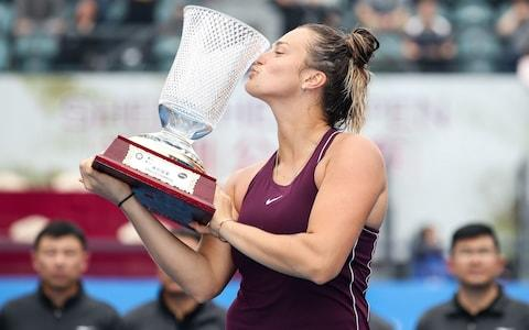 Gold medalist Aryna Sabalenka of Belarus kisses trophy after winning the women's singles final match against Alison Riske of United States on main draw day 7 of the 2019 WTA Shenzhen Open  - Credit: Getty Images