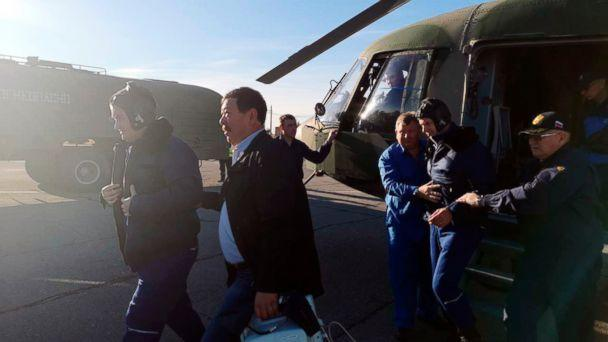 PHOTO: In this photo provided by Russian Defense Ministry Press Service, Russian cosmonaut Alexey Ovchinin, left, and NASA astronaut Nick Hague, second from right, are evacuated by the rescue team after an emergency landing, Oct. 11, 2018. (Russian Defense Ministry Press Service photo via AP)
