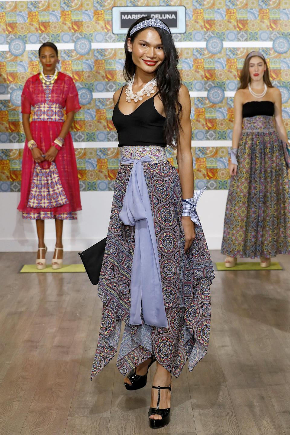 <p>MiMi, born in Thailand, was the first openly transgender model on <b>Project Runway</b> in 2019 and has been an advocate for the transgender community within the fashion industry. </p>
