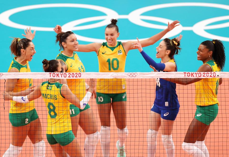 TOKYO, JAPAN - JULY 25: Gabriela Braga Guimaraes #10 of Team Brazil reacts with team mates against Team South Korea during the Women's Preliminary - Pool A on day two of the Tokyo 2020 Olympic Games at Ariake Arena on July 25, 2021 in Tokyo, Japan. (Photo by Toru Hanai/Getty Images)