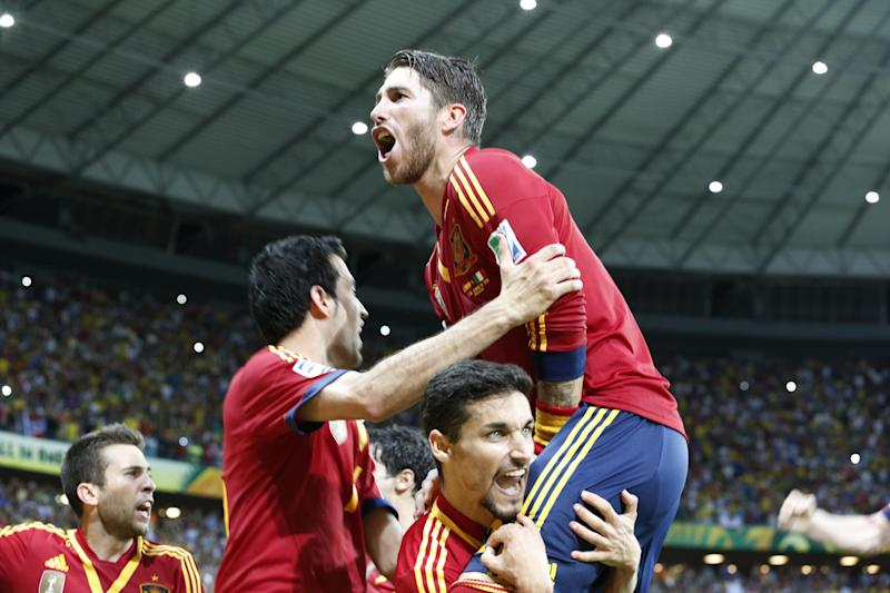 Spain's Sergio Ramos celebrates with teammates after beating Italy in a penalty shootout during the soccer Confederations Cup semifinal match at the Castelao stadium in Fortaleza, Brazil, Thursday, June 27, 2013. (AP Photo/Eugene Hoshiko)