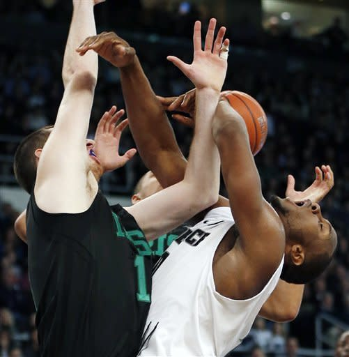 Providence's Kadeem Batts, right, runs into Notre Dame's Garrick Sherman's defense, left, in the first half of an NCAA college basketball game in Providence, R.I., Saturday, Feb. 16, 2013. (AP Photo/Michael Dwyer)