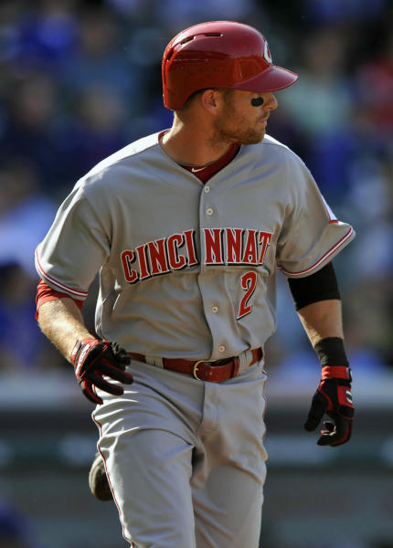 Cincinnati Reds' Zack Cozart watches his two-run home run during the seventh inning of a baseball game against the Chicago Cubs in Chicago, Sunday, April 20, 2014. (AP Photo/Paul Beaty)