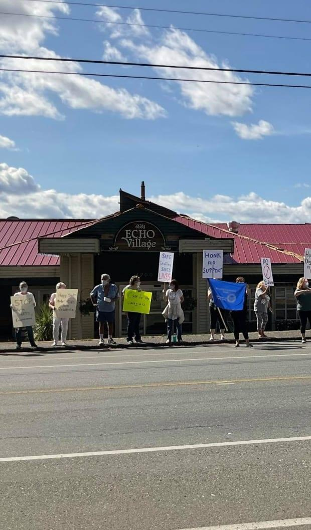Family and friends of residents at Echo Village long-term care home, along with former employees protest alleged