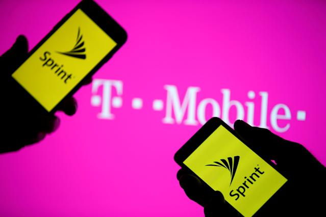 Smartphones with Sprint logo are seen in front of a screen projection of T-mobile logo, in this picture illustration taken April 30, 2018. REUTERS/Dado Ruvic/Illustration