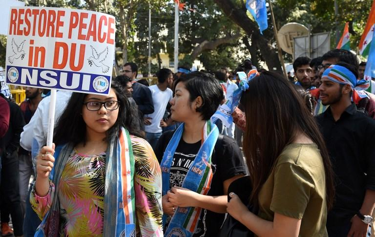 <p>Members of the National Students Union of India (NSUI) hold placards during a protest march at the Delhi University on February 23, 2017. Violent clashes between India's right-wing student group Akhil Bharatiya Vidyarthi Parishad (ABVP) and left-leaning All India Students Association (AISA) broke out at a Delhi University college over a seminar invitation to two student leaders, including one who was charged with sedition last year for allegedly chanting anti-national slogans at a university event which sparked nationwide debate on free speech. / AFP PHOTO / Money SHARMA </p>