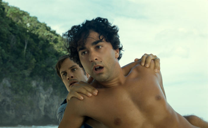 """This image released by Universal Pictures shows Gael García Bernal, left, and Alex Wolff in a scene from """"Old."""" (Universal Pictures via AP)"""