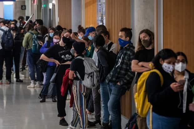 Students wait in line to cast their ballot at a polling station at the University of British Columbia in Vancouver on Monday.  (Ben Nelms/CBC - image credit)