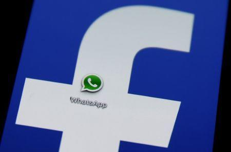 FILE PHOTO - A Whatsapp icon is seen on a phone screen with a Facebook logo in the central Bosnian town of Zenica, February 20, 2014. REUTERS/Dado Ruvic