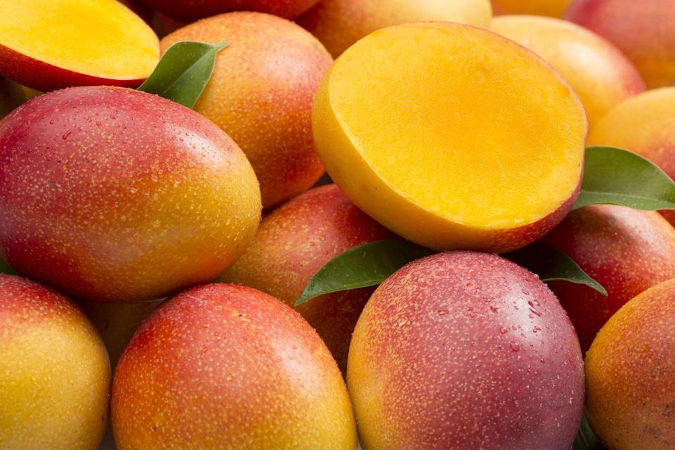 "<p>Munch on mango for a summery, delicious tropical treat filled with <a href=""https://www.goodhousekeeping.com/health/diet-nutrition/g35351259/vitamin-c-foods/"" rel=""nofollow noopener"" target=""_blank"" data-ylk=""slk:vitamin C"" class=""link rapid-noclick-resp"">vitamin C</a>, potassium-, and beta-carotene. We love making a big batch of mango-filled <a href=""https://www.amazon.com/Barbecue-Stainless-Reusable-Vegetable-Including/dp/B07TCDPXSX/ref=sr_1_3?tag=syn-yahoo-20&ascsubtag=%5Bartid%7C10055.g.28511617%5Bsrc%7Cyahoo-us"" rel=""nofollow noopener"" target=""_blank"" data-ylk=""slk:skewers"" class=""link rapid-noclick-resp"">skewers</a> and loading up the fridge or freezer, so they're always on hand when you need a nosh. Plus, the prep gets your little ones involved in the kitchen, and that kabob adds an extra layer of fun! Diced mango is wonderful in a salad, or freeze chunks to throw into <a href=""https://www.goodhousekeeping.com/food-recipes/healthy/g4060/healthy-smoothie-recipes/"" rel=""nofollow noopener"" target=""_blank"" data-ylk=""slk:smoothies"" class=""link rapid-noclick-resp"">smoothies</a>.</p>"