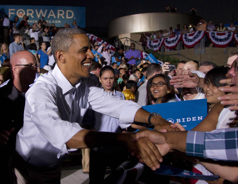 FILE - In this Aug. 14, 2012 file photo, U.S. President Barack Obama greets his supporters during a campaign event in Waterloo, Iowa. The world's two biggest economies are entering the final stages of political campaigns to pick their national leaders. While American candidates wage loud, rah-rah campaigns with a clear timetable as they head toward the Nov. 6 presidential election, China hasn't even announced the date for this fall's Communist Party congress that will appoint the next top leader to replace outgoing Hu Jintao - a post widely expected to go to Vice President Xi Jinping. (AP Photo/Carolyn Kaster, File)