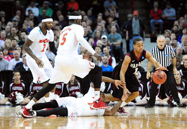 SPOKANE, WA - MARCH 20: Siyani Chambers #1 of the Harvard Crimson gets a loose ball while Ge'Lawn Guyn #14, Titus Rubles #2, and Justin Jackson #5 of the Cincinnati Bearcats go for the ball during the second round of the 2014 NCAA Men's Basketball Tournament at Spokane Veterans Memorial Arena on March 20, 2014 in Spokane, Washington. (Photo by Steve Dykes/Getty Images)