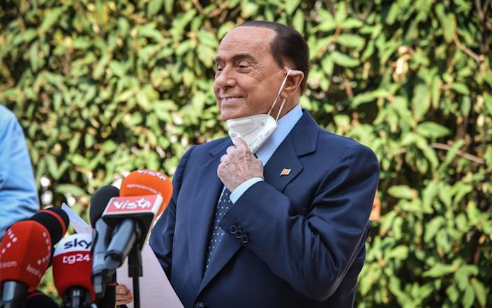 Silvio Berlusconi speaks to the media as he leaves San Raffaele hospital in Milan - Shutterstock