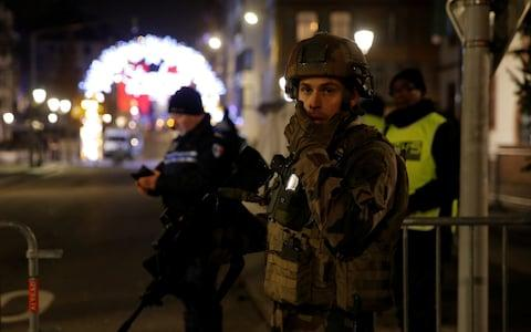 Police officers secure a street and the surrounding area after a shooting in Strasbourg - Credit: VINCENT KESSLER/Reuters