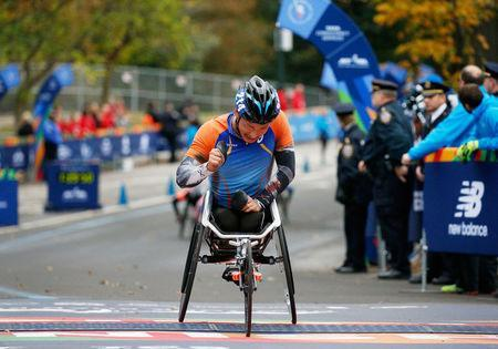 Sho Watanabe of Japan celebrates at the finish line of the New York City Marathon after winning the 3rd place in wheelchair race in Central Park in New York, U.S., November 5, 2017. REUTERS/Brendan McDermid
