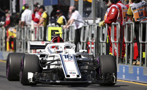 Sauber driver Charles Leclerc of Monaco drives down pit lane during the first practice session at the Australian Formula One Grand Prix in Melbourne, Friday, March 23, 2018. The first race of the 2018 seasons is on Sunday. (AP Photo/Rick Rycroft)