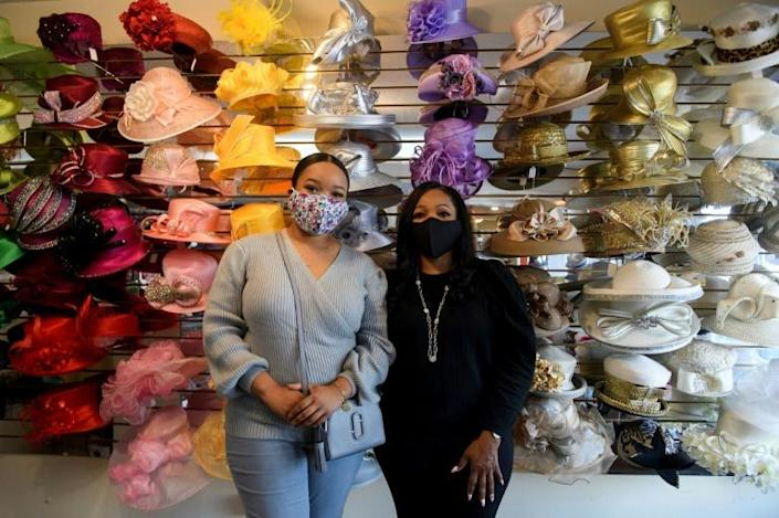 Meeka Robinson Davis, owner of One-Of-A-Kind Hats and daughter Chrstiana Davis at their store in the Windsor Hills neighborhood of Los Angeles -- Covid has hit business badly