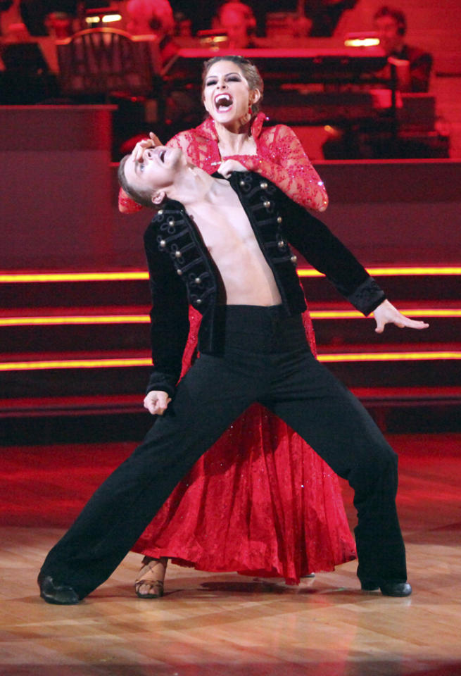 TV hostess with the mostest Maria Menounos channeled her inner vampire during the seventh week of the competition by dancing a paso doble -- with pro partner Derek Hough -- in fangs and a blood-red frock fit for a bloodsucker. Despite their looking a bit demented, the duo earned a perfect 30/30 from the judges.