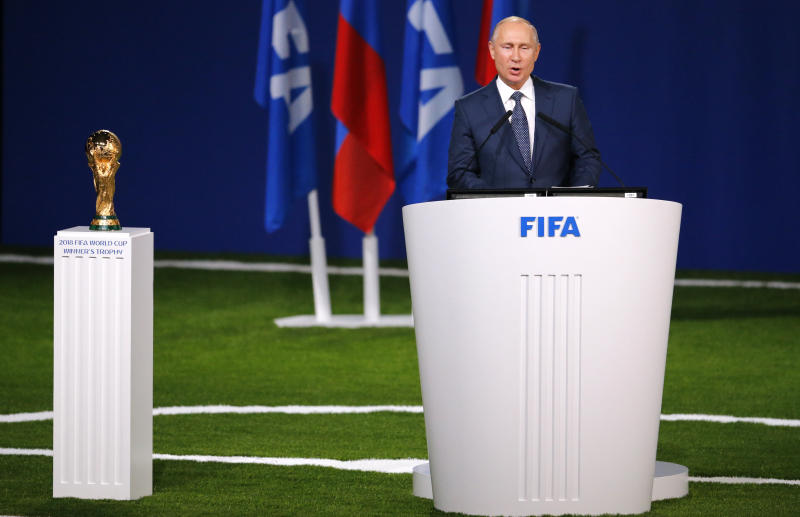 Russian President Vladimir Putin speaks to global soccer leaders at the FIFA congress on the eve of the opener of the 2018 soccer World Cup in Moscow Russia Wednesday