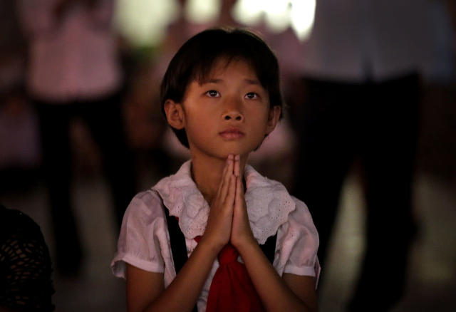 <p>A North Korean girl watches as fireworks explode, July 27, 2014, in central Pyongyang, North Korea. North Koreans gathered at Kim Il Sung Square to watch a fireworks display as part of celebrations for the 61st anniversary of the armistice that ended the Korean War. (Photo: Wong Maye-E/AP) </p>