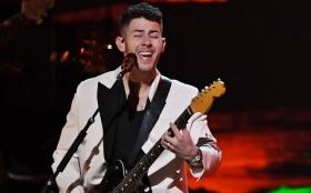 Eww: Nick Jonas performs with food stuck in his teeth during the Grammys
