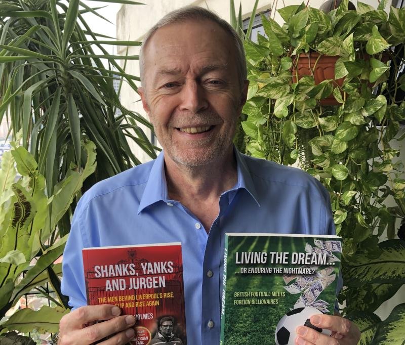 Veteran sportswriter Bob Holmes with his two books on English football. (PHOTO: Courtesy of Bob Holmes)
