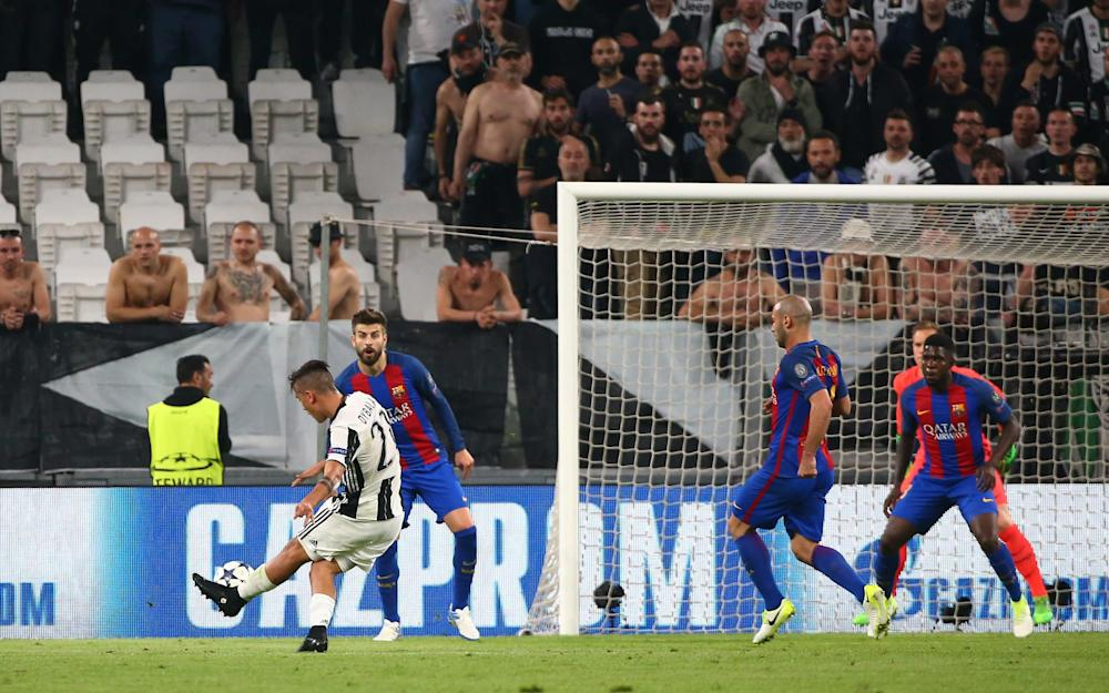 Paulo Dybala scores their second goal - Credit: REUTERS