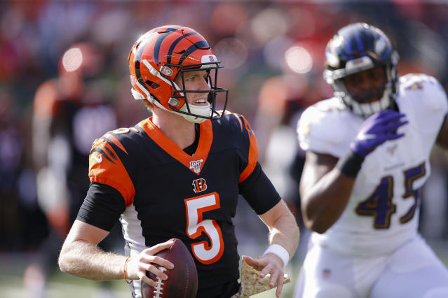 Cincinnati Bengals quarterback Ryan Finley (5) looks to pass under pressure from Baltimore Ravens linebacker Jaylon Ferguson (45) during the first half of NFL football game, Sunday, Nov. 10, 2019, in Cincinnati. (AP Photo/Gary Landers)