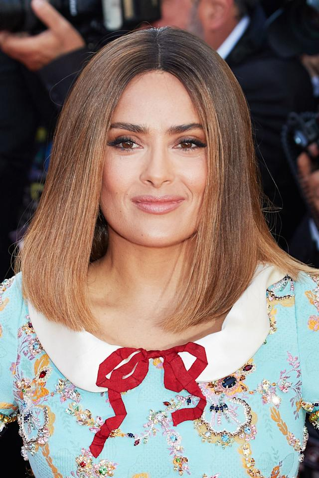 <p>Salma wears face-framing toffee accents. </p>