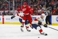 Detroit Red Wings center Robby Fabbri (14) tries to jump around Florida Panthers defenseman Mike Matheson (19) for the puck during the first period of an NHL hockey game Saturday, Jan. 18, 2020, in Detroit. (AP Photo/Paul Sancya)