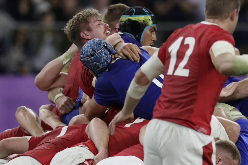 France's Sebastien Vahaamahina, wearing a black helmet, receives a red card after the play during the Rugby World Cup quarterfinal match at Oita Stadium between Wales and France in Oita, Japan, Sunday, Oct. 20, 2019. (AP Photo/Aaron Favila)