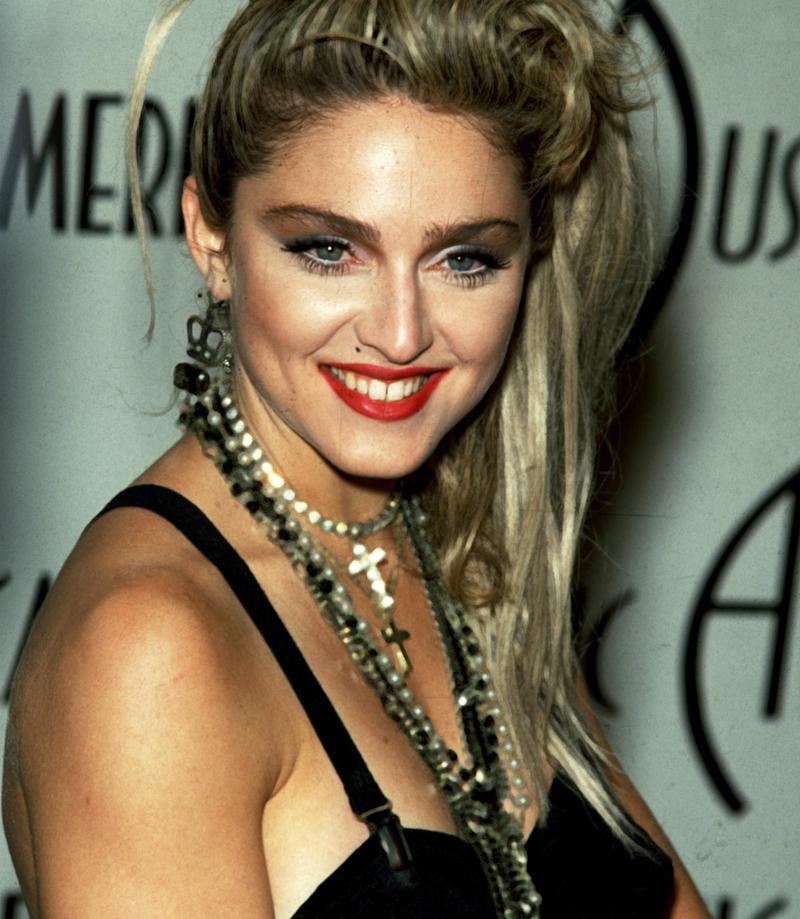 Madonna, pictured here in 1985, often wore crosses and even rosary beads around her neck in the early days of her career.