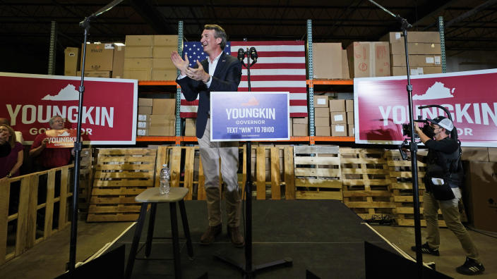 Republican gubernatorial candidate, Glen Youngkin, applauds as he surveys the crowd during an event in Richmond, Va., Tuesday, May 11, 2021. (AP Photo/Steve Helber)