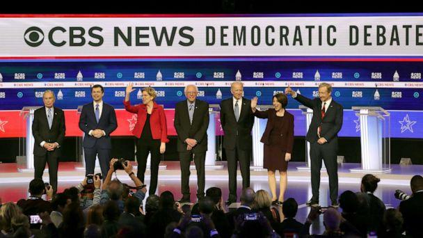 PHOTO: Democratic presidential hopefuls arrive on stage for the tenth Democratic primary debate at the Gaillard Center in Charleston, South Carolina, Feb. 25, 2020. (Win Mcnamee/Getty Images)