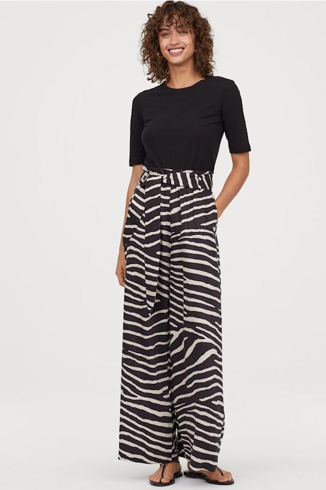 "<p>We're so into the zebra print of these <a href=""https://www.popsugar.com/buy/H%26amp%3BM%20Wide-Leg%20Pants-473576?p_name=H%26amp%3BM%20Wide-Leg%20Pants&retailer=www2.hm.com&pid=473576&price=25&evar1=fab%3Aus&evar9=46433464&evar98=https%3A%2F%2Fwww.popsugar.com%2Ffashion%2Fphoto-gallery%2F46433464%2Fimage%2F46433650%2FHM-Wide-Leg-Pants&list1=shopping%2Cpants%2Csummer%2Ctrousers%2Csummer%20fashion&prop13=api&pdata=1"" rel=""nofollow"" data-shoppable-link=""1"" target=""_blank"" class=""ga-track"" data-ga-category=""Related"" data-ga-label=""https://www2.hm.com/en_us/productpage.0752512008.html"" data-ga-action=""In-Line Links"">H&amp;M Wide-Leg Pants</a> ($25).</p>"