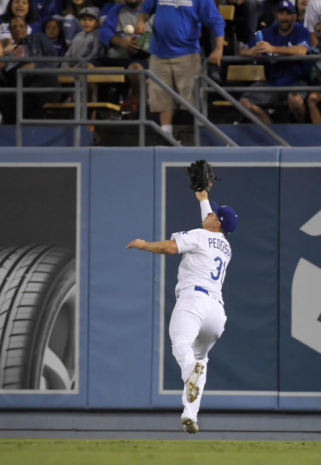 Los Angeles Dodgers right fielder Joc Pederson makes the catch on a ball hit by St. Louis Cardinals' Andrew Knizner during the seventh inning of a baseball game Tuesday, Aug. 6, 2019, in Los Angeles. (AP Photo/Mark J. Terrill)