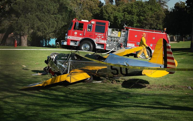 A small plane owned by Harrison Ford is seen after crashing at the Penmar Golf Course in Venice, California in 2015 - Credit: AFP