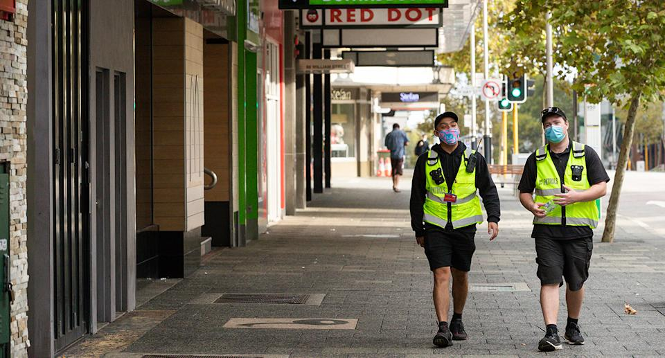City of Perth Safe City Patrol workers are seen in Perth, Monday, April 26, 2021. Perth and Peel region are expected to come out of a three day lockdown at midnight but mask will still be compulsory until at least 12:01am next Saturday when restrictions are reviewed. (AAP Image/Richard Wainwright) NO ARCHIVING