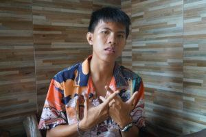 Thanayuth 'Book' Na Ayutthaya, 18, raps about Khlong Toei and social justice. Photo: Coconuts