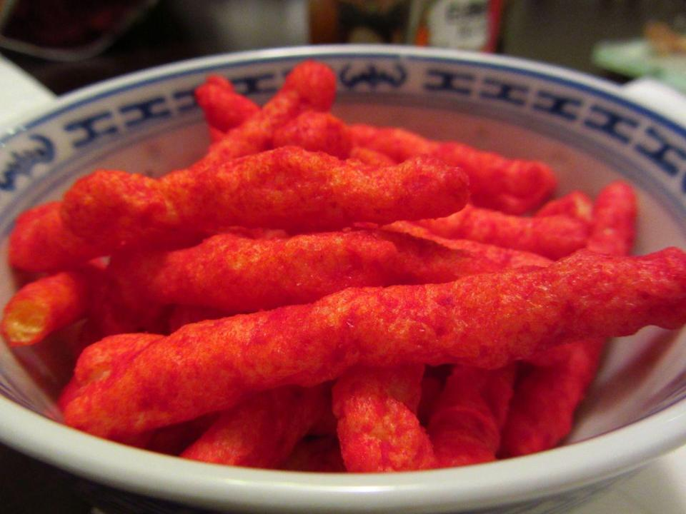 """<p>A janitor invented <a href=""""/cooking/a51499/things-you-should-know-before-eating-flamin-hot-cheetos/"""" data-ylk=""""slk:Flamin' Hot Cheetos"""" class=""""link rapid-noclick-resp"""">Flamin' Hot Cheetos</a> by sprinkling chili power on the traditional crunchy variety. He presented the idea to execs and has since become an executive VP at PepsiCo's North American division.</p>"""
