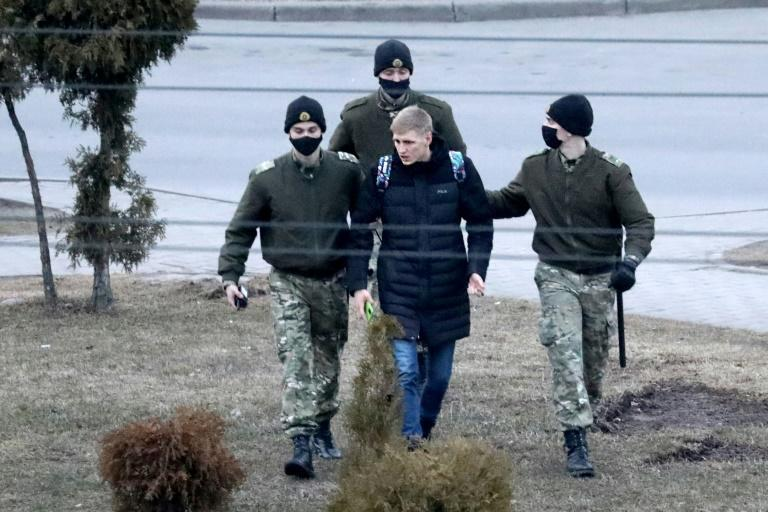 Law enforcement officers detain a man in Minsk after the opposition called for supporters to gather in small groups in every district